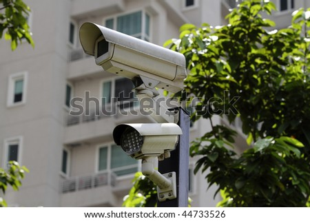 A security camera with LED light at the perimeter of a residential building - stock photo