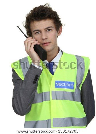 A security guard holding a radio, isolated on white