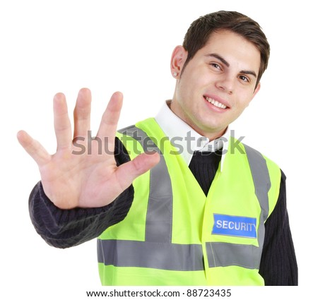 A security guard holding his hand out. - stock photo