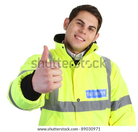 A security guard with a thumbs up sign - stock photo