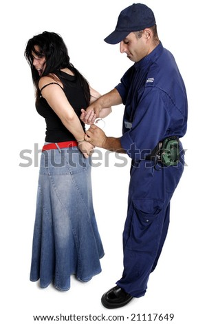A security officer apprehends and handcuffs a female person. - stock photo
