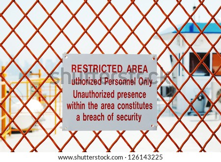 A security sign outside a restricted area - stock photo
