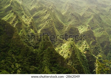 A segment of the Nuuanu Pali as seen from Hoomaluhia Botanical Gardens, Oahu Hawaii, USA. - stock photo