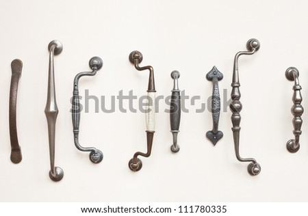 A selection of antique wrought iron door handles - stock photo