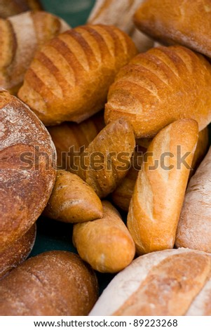 a selection of bread at a market. - stock photo
