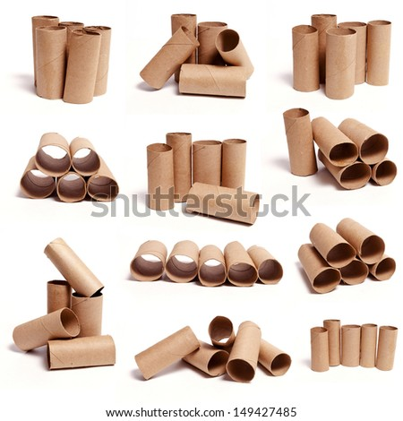 A selection of cardboard toilet paper tubes in various arrangements isolated on a white background. - stock photo
