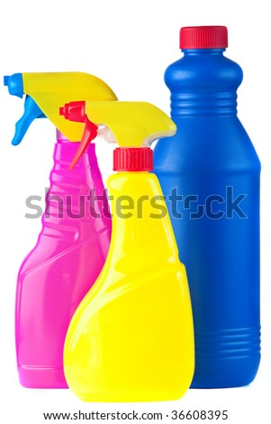 A selection of colourful bottles of cleaning supplies isolated on white. - stock photo