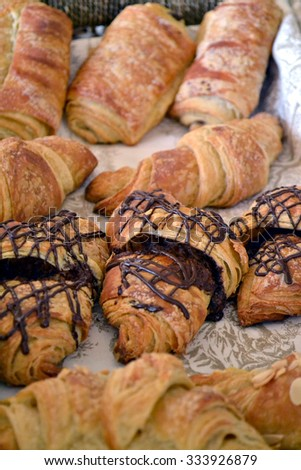 A selection of croissants and other pastries in a bakery. - stock photo