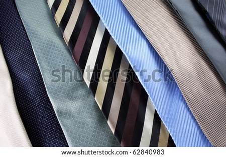 a selection of different colored ties - stock photo