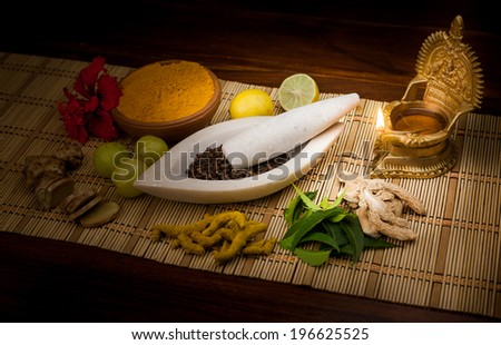 A selection of natural ingredients arranged in and around a marble mortar and pestle. - stock photo