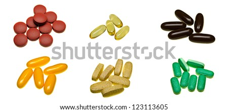 A selection of pill tablets isolated on white - stock photo