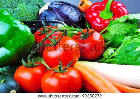 A selection of summer seasonal organic vegetables - stock photo