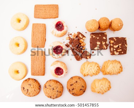 A selection of tea biscuits on white background in studio.