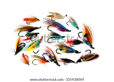 A selection of traditional trout and salmon fishing flies isolated on a white background - stock photo