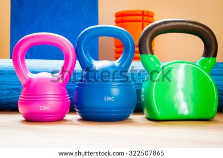 A selection of vibrant kettlebells in a pilates studio