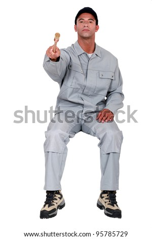 A self-righteous painter sitting on an invisible object - stock photo