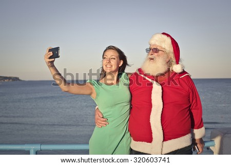 A selfie with Santa Claus - stock photo