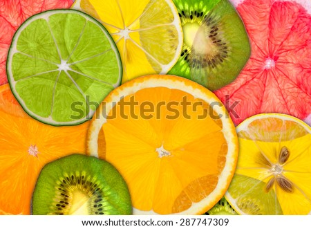 A semi transparent background of various citrus fruits with bright back-light. - stock photo