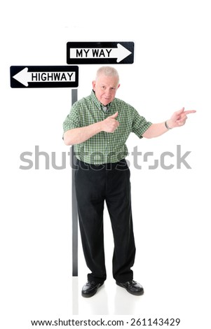 """A senior adult man standing before a """"My Way"""" and the """"Highway"""" signs.  He's happily pointing in the """"My Way"""" direction while giving a thumbs-up gesture.  On a white background. - stock photo"""