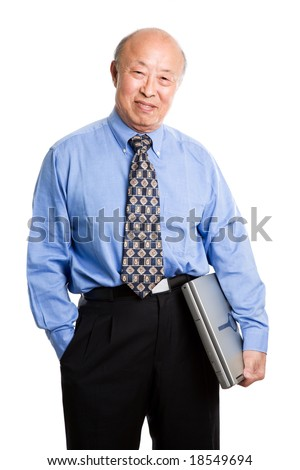 A senior asian businessman holding a laptop - stock photo
