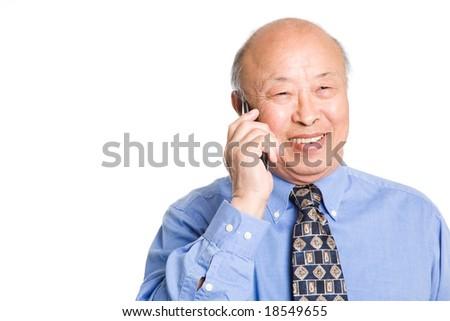 A senior asian businessman talking on the phone - stock photo