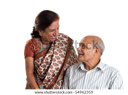 A senior Asian couple having a laugh together - isolated in white - stock photo