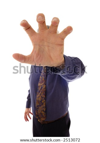 A senior businessman, in shirtsleeves, reaching out into the viewer's face - stock photo