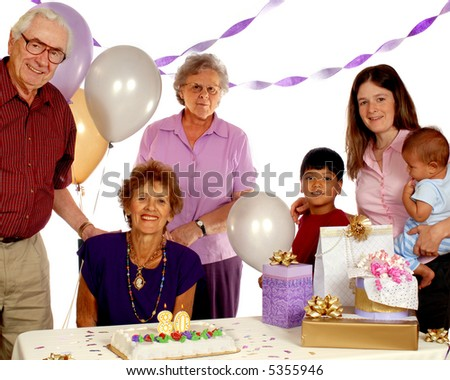 A senior celebrating her 80th birthday with family and friends. - stock photo