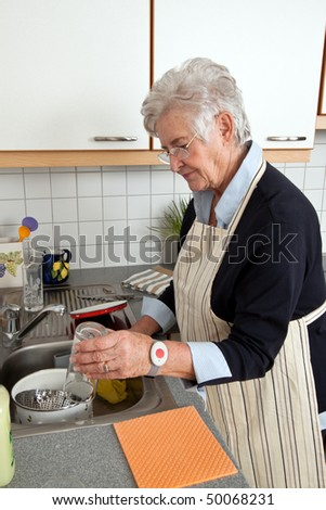 A senior citizen with the dishes of their dishes - stock photo