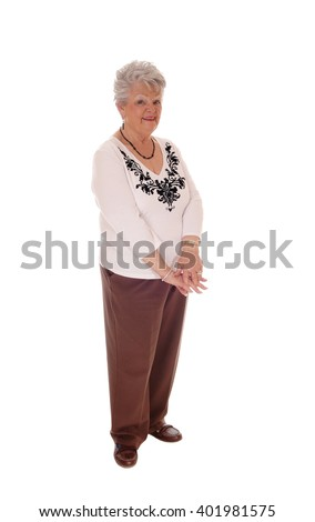 A senior citizen woman standing full length in brown pants and sweater,isolated for white background. - stock photo