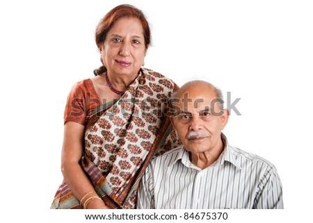 A senior Indian / Asian couple - isolated on white - stock photo