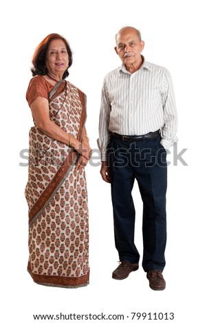 A senior Indian / Asian couple standing - isolated on white - stock photo