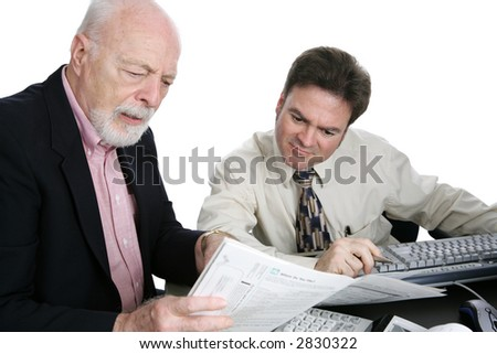 A senior man confused the his tax forms and seeking advice from an accountant.  Isolated on white. - stock photo
