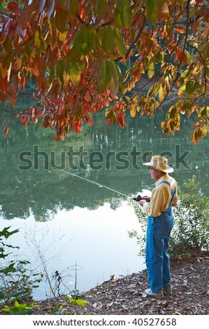 A senior man fishing from the bank.