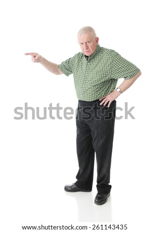 A senior man glaring at the viewer while pointing to the right.  On a white background. - stock photo