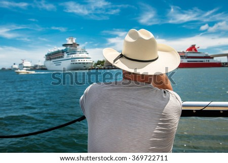 A senior man going back to cruise ship after island tour - stock photo