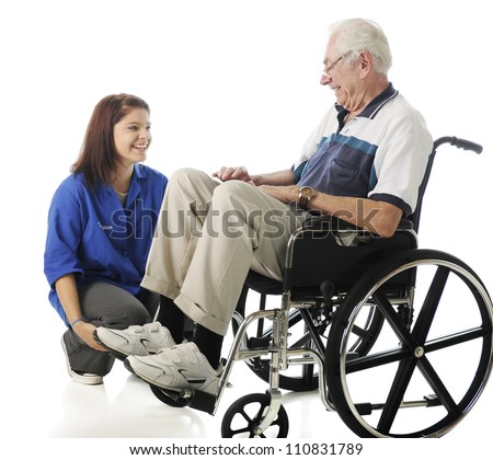 A senior man in a wheelchair and teen volunteer enjoying each other's company.  On a white background. - stock photo