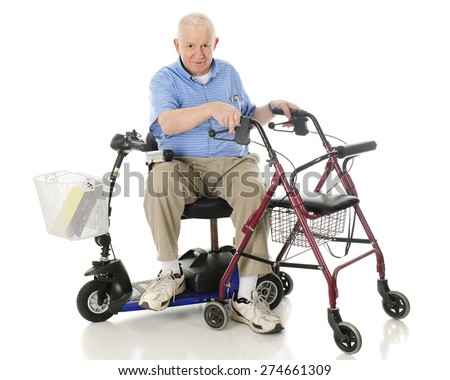 A senior man sitting sideways on his power scooter while holding onto the handles of his wheeling walker.  On a white background. - stock photo