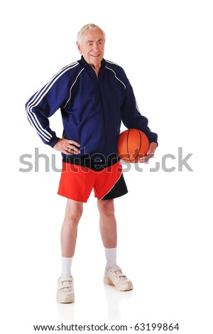 A senior man standing with a basketball in sport shorts and a jacket.  Isolated on white. - stock photo