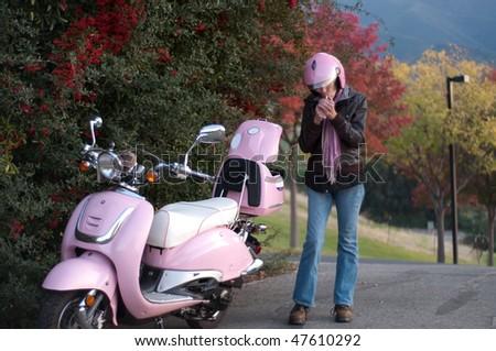 a senior taking a cigarette break after bike ride - stock photo