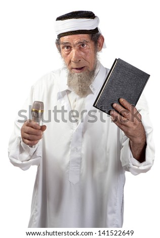 A senior with a microphone and book delivers a message. - stock photo
