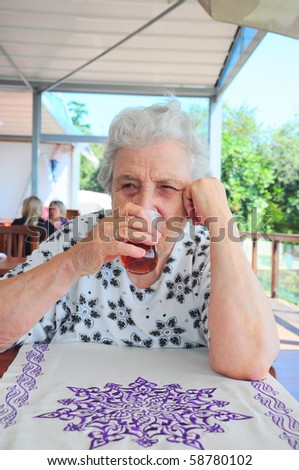 a senior woman drinking tea - stock photo