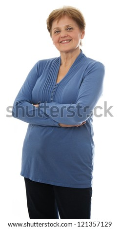 a senior woman - over sixty years old standing on white background - stock photo