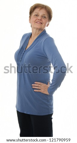 a senior woman - over sixty years old standing - white background - stock photo