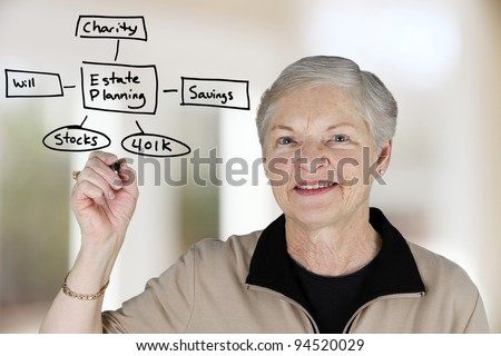 A senior woman planning out her estate - stock photo