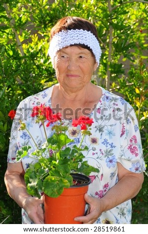 A Senior woman tending to a hibiscus