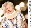 A Senior Woman Wearing A Neck brace, Outdoor - stock photo