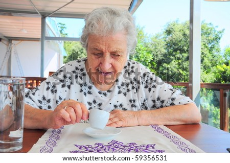 a senior woman with coffee cup - stock photo