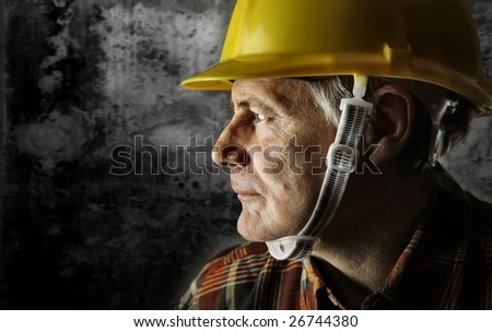 a senior worker with an hardhat - stock photo