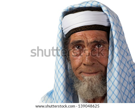 A senor man in traditional garment appears in thought - stock photo